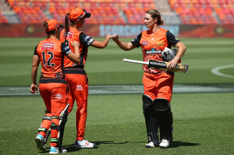Sophie Devine of the Scorchers celebrates with Piepa Cleary.