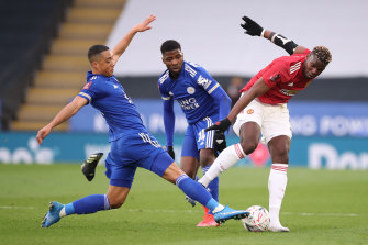 Paul Pogba is challenged by Youri Tielemans at the King Power Stadium.
