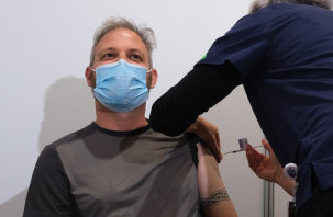 Victoria's Chief Health Officer Brett Sutton receives the vaccine at the Royal Exhibition Building.