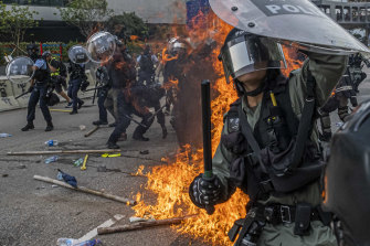 Protesters clash with police officers in Kowloon Bay in Hong Kong, August 24, 2019.