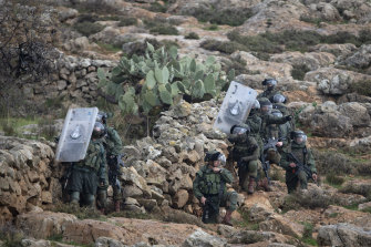 Israeli border police take position during clashes with Palestinian protesters in the village of Mughayer on Friday.