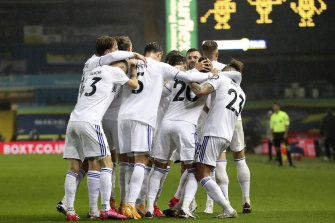 Leeds players celebrate their goal. Their draw with City leaves them in fifth spot.