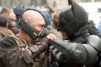 Tom Hardy's Bane faces off with Christian Bale's Batman in The Dark Knight Rises.