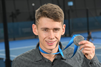 Alex de Minaur with his medal last year.