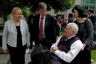 John Walsh (bottom right) in 2011, then Associate Commissioner of the Productivity Commission, with ministers in the then-Labor government, Jenny Macklin and Bill Shorten.