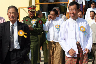 Lo Hsing Han, left, and his son Stephen Law at the opening of the Yangon international airport in 2007.