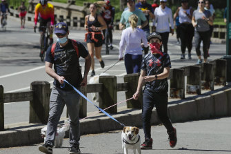 People enjoy the outdoors in New York's Central Park as some lockdown measures eased over the weekend.