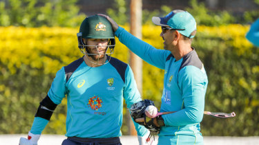 Langer (right) is thrilled to have David Warner and Steve Smith back in the fold.