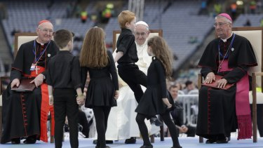 Pope Francis watches dancing children at the Festival of Families in Croke Park Stadium in Dublin, Ireland, on Saturday.