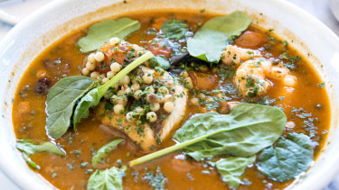 The fish stew with fregola, cherry tomatoes, olives and capers.