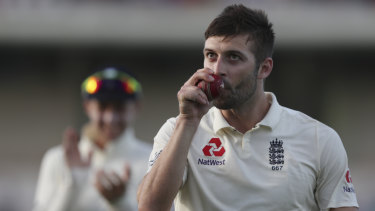 England's Mark Wood kisses the ball after taking five wickets against the West Indies.
