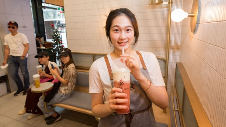 Cheese tea is tipped as one the food trends of 2019. Pictured, Gotcha Tea staffer Nadia with a strawberry macchiato cheese tea.