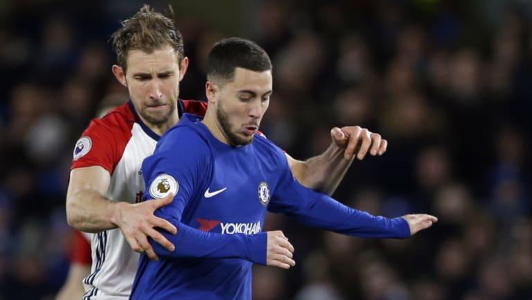 Eden Hazard shrugs off a challenge from West Brom's Craig Dawson.
