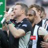 Collingwood coach Nathan Buckley speaks to his players, with coaching during games set to be revolutionised by the introduction of play-calling symbols on LED boards.
