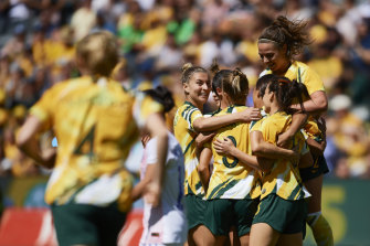 Prolific: The Matildas gather around Sam Kerr after she struck against Chile.