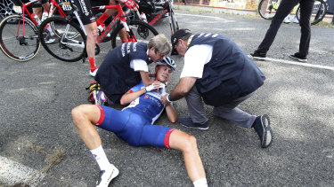 Netherlands' Niki Terpstra receives medical attention after crashing during the eleventh stage.