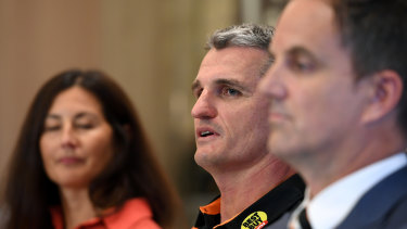 Getting off the bus: West Tigers chair Marina Go and CEO Justin Pascoe with Ivan Cleary.