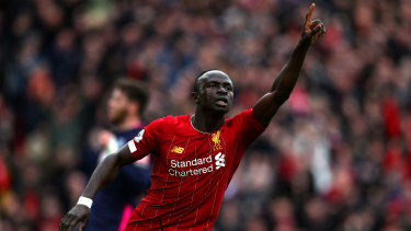 Sadio Mane celebrates after scoring Liverpool's second goal against AFC Bournemouth  at Anfield.