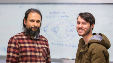 UQ physicist Dr Fabio Costa (left) with student Germain Tobar.