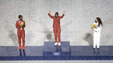 Silver medallist Brigid Kosgei of  Kenya, gold medallist Peres Jepchirchir also of Kenya and bronze medallist Molly Seidel of the United States.