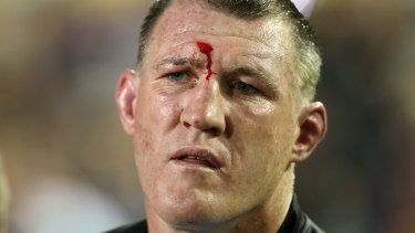 Paul Gallen watches from the sideline in his last NRL game.