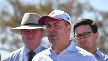 Josh Frydenberg, centre, former deputy prime minister Barnaby Joyce, left, and Drought Minister David Littleproud in Inverell yesterday.