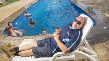 Lake Eppalock Holiday Park owner and operator Peter Rose gets a rare moment's rest by the pool during the summer school holiday peak.
