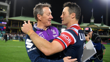 Craig Bellamy and Cooper Cronk embrace after the Roosters knocked the Storm out last week.