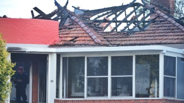A man died after re-entering a house at Rodd Point to battle a fire.