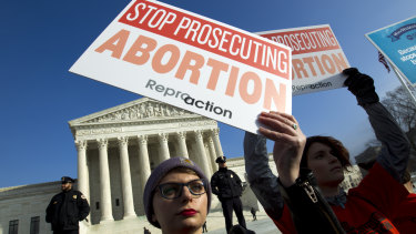 Abortion rights activists protest at the US Supreme Court during the March for Life in Washington.