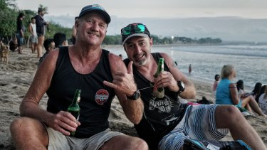 Tim Ryan, right, and Paul Sage at Kuta beach in Bali after it reopened.