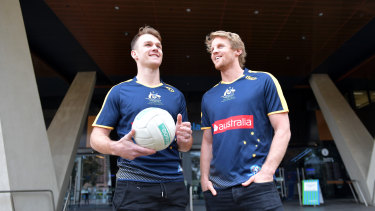 Rory Sloane (right) and Robbie Gray promote the hybrid rules series in 2017.