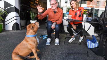 Frank, his owner Mick Barnes, and vet Leigh Davidson at the Black Toast cafe in Annandale.