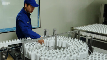 "Bottles of cockroach essence ""healing potion"" make their way through the production line."