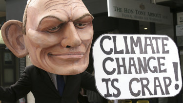 A demonstrator with a giant head in the likeness of former prime minister Tony Abbott holds a sign referencing his 2017 remark belittling the science of climate change during a student-organised protest in Sydney this month.