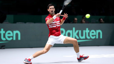 Novak Djokovic rips a forehand against Yoshihito Nishioka of Japan.