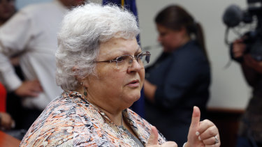 Susan Bro, mother of Heather Heyer who was killed in 2017 during a white supremacist rally, gives a thumbs up to the press after the sentencing of James Alex Fields jnr in federal court in Charlottesville, Virginia.