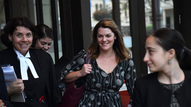 Greens Senator Sarah Hanson-Young (centre) and her barrister, Sue Chrysanthou SC (left) outside court.