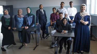 Al-Faisal College's stars of HSC maths:  Aisha Duncan , Sadan Taher, Joanne Zreika, Head Maths teacher Mohamad Jamal, Muneeb Zafar, Haiwad Rashtia, Tabeeb Bin Mashiur, Safa Rashid, Ibrahim Shukri and dux Dania Al Rifai.