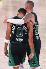 Jayson Tatum and Daniel Theis celebrate after Boston's win over Miami.