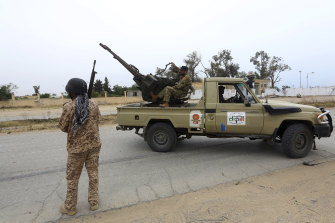 Government forces on patrol outside Tripoli.