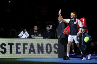 Stefanos Tsitsipas waves to fans as he walks out prior to his singles final match against Dominic Thiem.
