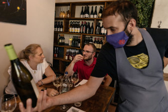 Michelle Crippa (centre) lunches with a friend at a restaurant in Piacenza, Italy.