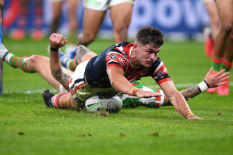 Kyle Flanagan scores for the Roosters on Friday night.