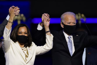 Kamala Harris and Joe Biden celebrate.