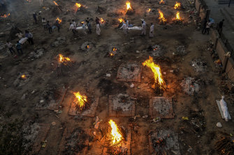 New bodies arrive at a mass cremation site in Delhi, India, April 23, 2021. US government administration officials are coming under increasing pressure to lift restrictions on exports of supplies that vaccine makers in India say they need to expand production amid a devastating surge in COVID-19 deaths there.