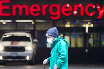 An elderly woman walks past the Emergency Department of the Vancouver General Hospital in British Columbia.