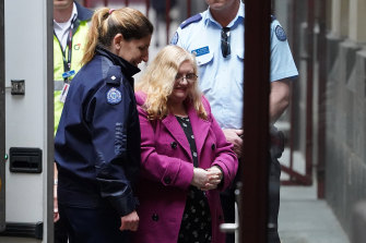 Christine Lyons being led into the Supreme Court in 2018.