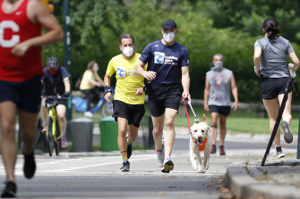 Vaccinated Americans exercising outdoors alone or with members of their household will no longer have to wear a mask under new CDC guidelines.