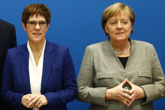 Annegret Kramp-Karrenbauer, left, is a protegee of Chancellor Angela Merkel.